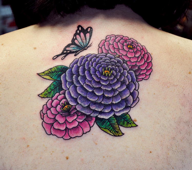 tattoo of zinnia flowers and a butterfly