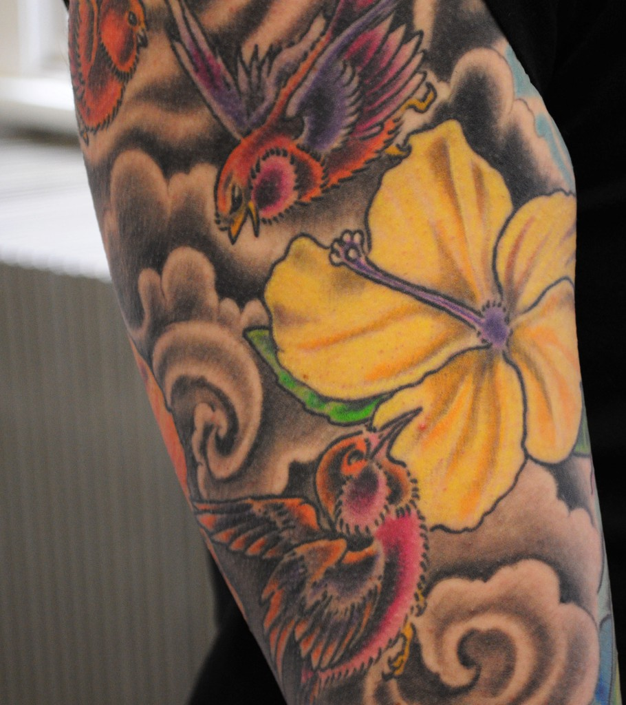 tattoo of birds and a yellow flower