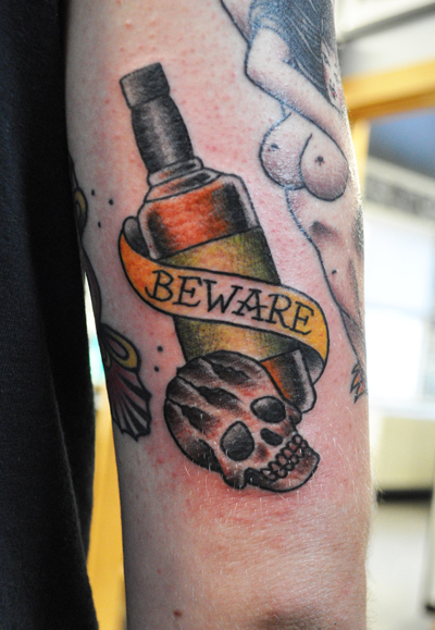 whiskey bottle and skull tattoo