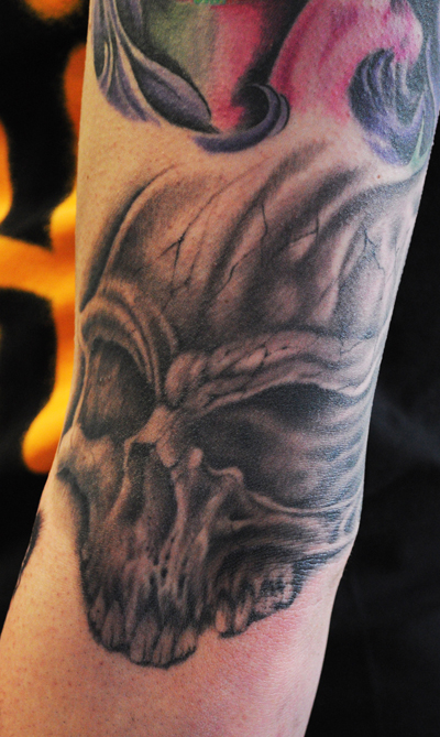 tattoo of a skull on the bend on the elbow